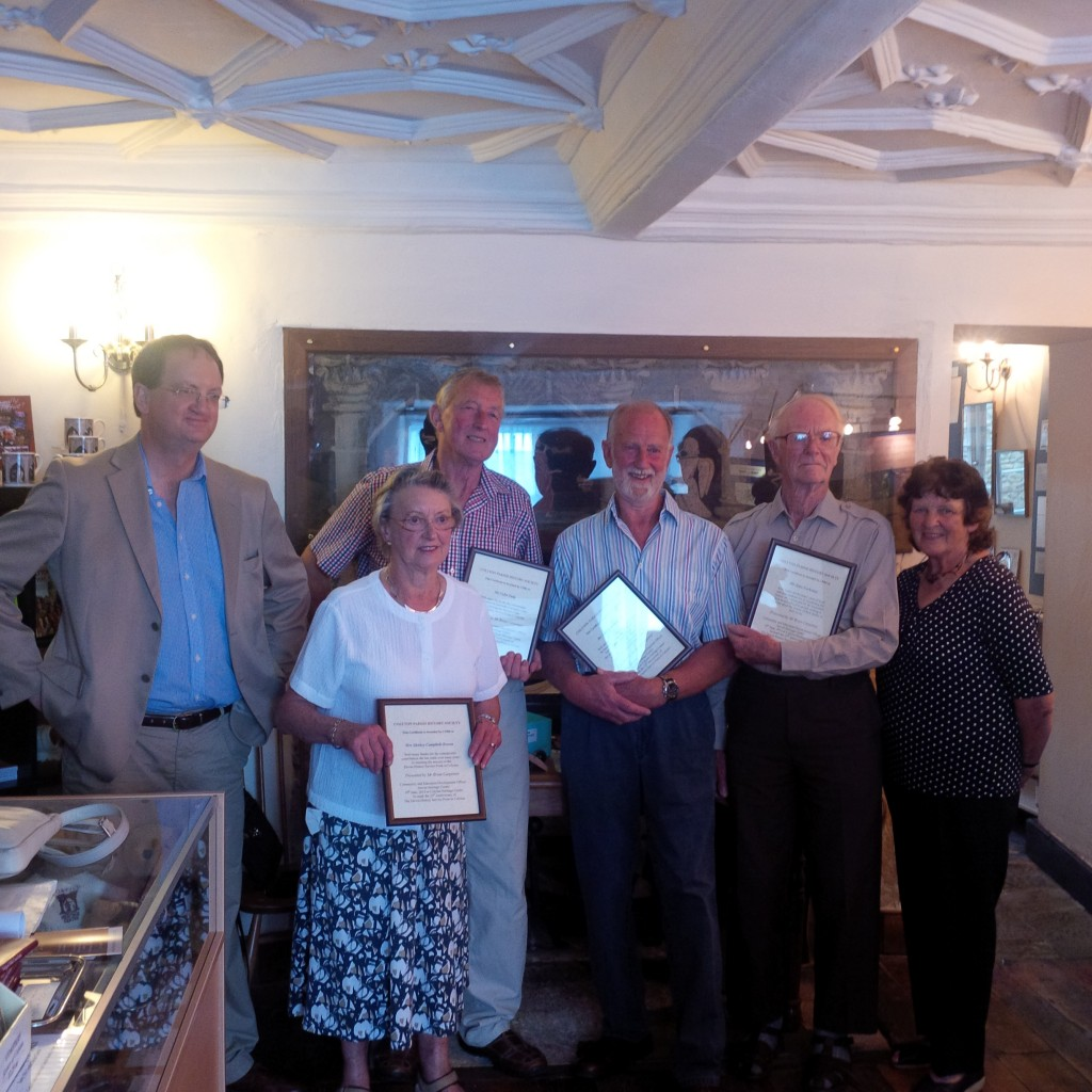 CPHS members Shirley Campbell Brown, Colin Pady, John Forrester Addie and John Cochrane holding long service awards presented to them by Brian Carpenter during the celebrations on 19 June 2014 - marking Colyton's 25 successful years as a Devon History Service Point.  The  Open Day was held in the new Heritage Centre with CPHS Chairman Marion Sydenham  (on the right) welcoming everyone to the event