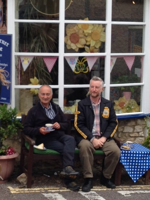 Tony Robinson with Billy Bragg enjoying a break outside the Olde Corner Shoppe, Colyton